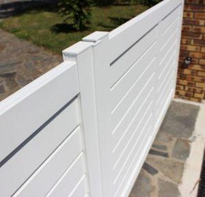 cloture aluminium blanche technal menuiserie maison jardin sécurité